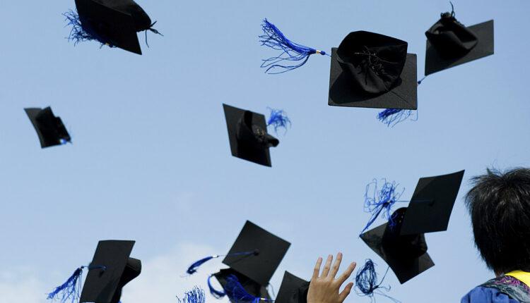 Graduation-Cap-Throwing-Stock-Image.jpg