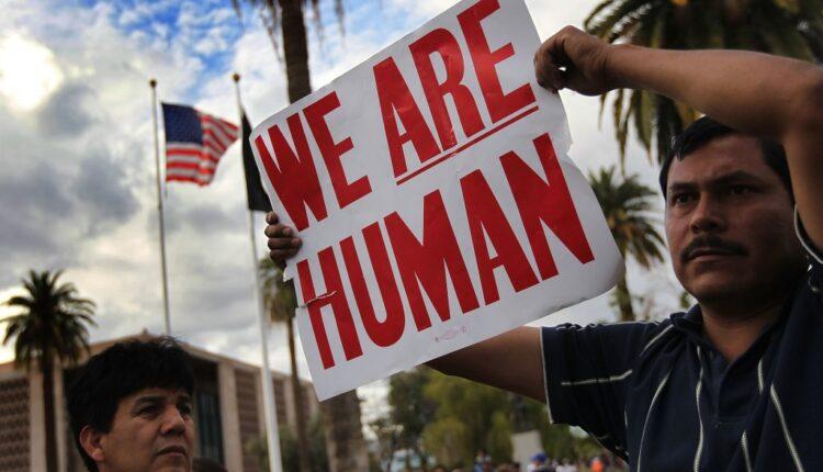 protest-human-sign-1024×695-1.jpg